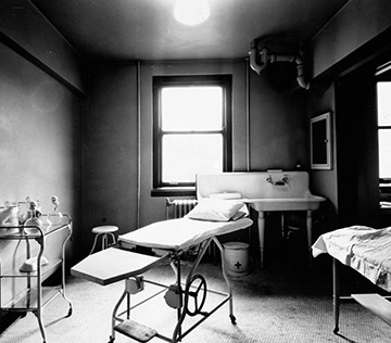 A black and white photo of a surgical dressing room