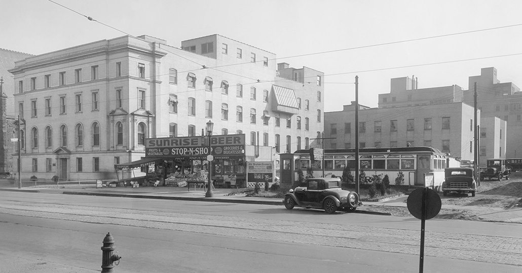 black and white image of a diner and a convenient store next to a hospital
