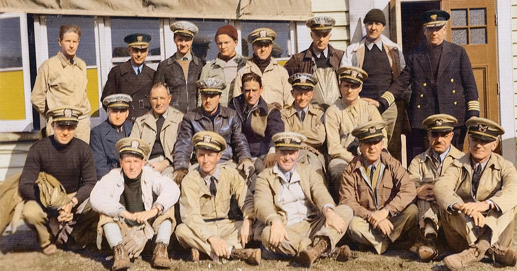 Image of the naval reserve unit, all wearing khaki uniforms and hats