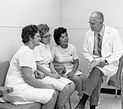 Dr. Rupert Turnball, MD with 3 women