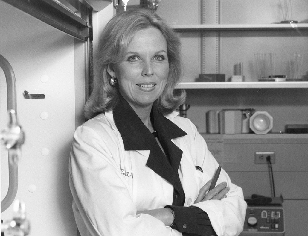 black and white image of Dr. Bernadine Healy leaning up against the wall.