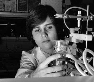 Christine Moravec, PhD holding a glass tool