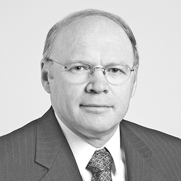 Lars Svensson headshot. He is wearing a suit and tie