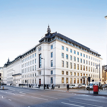 Outdoor photo of a white 5-story building in London.