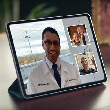 Doctor having a video call with patients and family