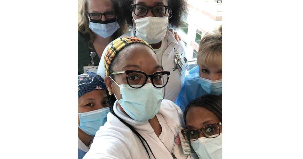 a picture of 6 nurses is PPE gear