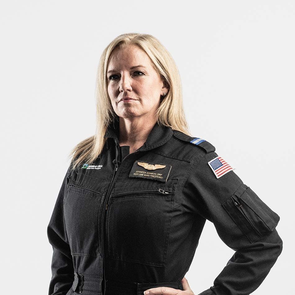 Jennifer Adamski posing for photo in uniform
