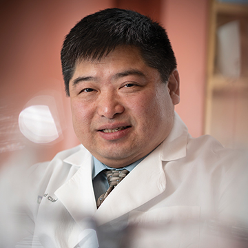 Dr. Timothy Chan smiling at the camera