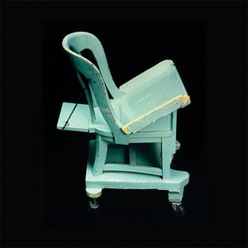 A seafoam green wooden chair