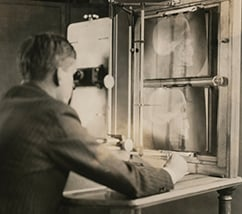 a Cleveland Clinic radiologist analyzing a head X-ray in the 1920s.