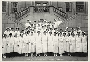 nurses pose outside Cleveland Clinic  Hospital's main entrance.