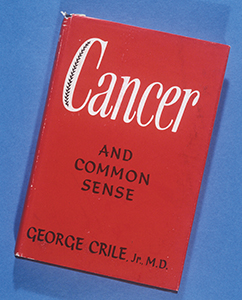 Image of a red book with Cancer printed on the cover in white
