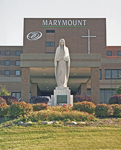 Marymount Hospital with a Mary status in front of building