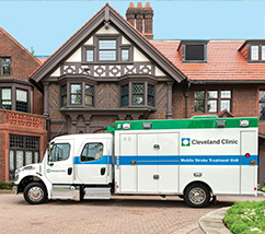 An ambulance parked in front of a colonial house